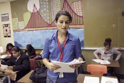 English teacher Corinna Lefkowitz distributes final exams on June 8 at Richmond High School. 